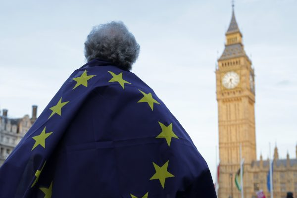 A protester draped in a European Union flag outside the Houses of Parliament