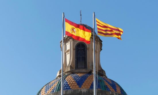 The Catalan and Spanish flags on Palau de la Generalitat, seat of the government of Catalonia, in Barcelona, Spain, on Oct. 3, 2018. (Anna Llado/Special to The Epoch Times)
