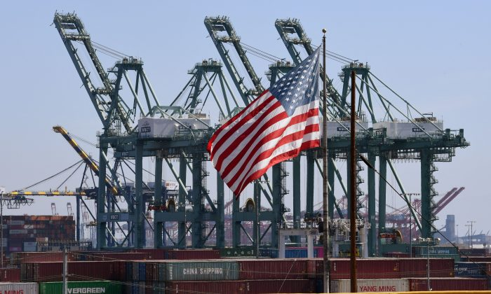 The U.S. flag flies over Chinese shipping containers at the Port of Long Beach in Los Angeles County on Sept. 29, 2018. (Mark Ralston/AFP/Getty Images)