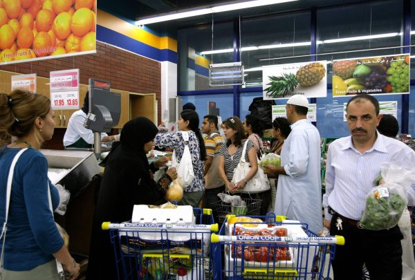 Emiratis and foreigners shop at a supermarket in Dubai in this file photo.
