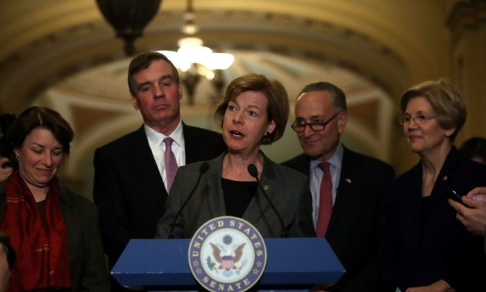 Sen. Tammy Baldwin (C) (D-Wis.) speaks with Sen. Amy Klobuchar (L) (D-Minn.) Sen. Mark Warner (2L) (D-Va.) Senate Minority Leader Charles Schumer (2R) (D-N.Y.) and  Sen. Elizabeth Warren (R) (D-Mass.)by her side during a news conference on Capitol Hill in Washington, D.C. on March 14, 2017. (Justin Sullivan/Getty Images)