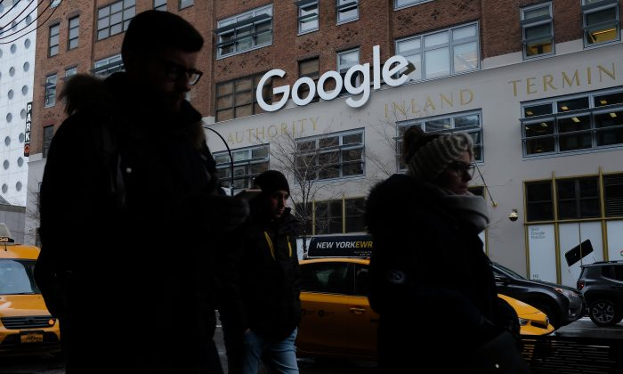People walk past a Google office building in New York City on Dec. 30, 2017. (Sean Gallup/Getty Images)