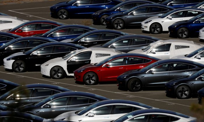 Rows of the new Tesla Model 3 electric vehicles are seen in Richmond, California, U.S., on June 22, 2018.  (Stephen Lam/Reuters)