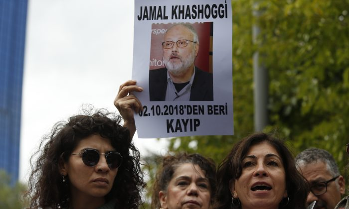 Activists, members of the Human Rights Association Istanbul branch, holding posters with photos of missing Saudi journalist Jamal Khashoggi in Istanbul, Turkey, on Oct. 9, 2018. (Lefteris Pitarakis/AP)