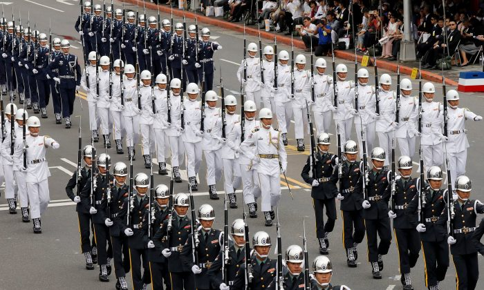 Military honor guards take part in the National Day celebrations in Taipei on Oct. 10, 2018. (Tyrone Siu/Reuters)