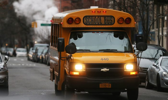 A school bus drives down a street in Manhattan's East Village in New York City on Jan. 15, 2013. (Mario Tama/Getty Images)