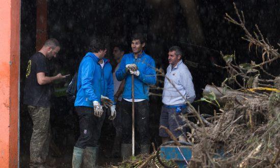 Tennis Ace Rafael Nadal Helps Clean Up Flood Devastation on Spanish Island Majorca