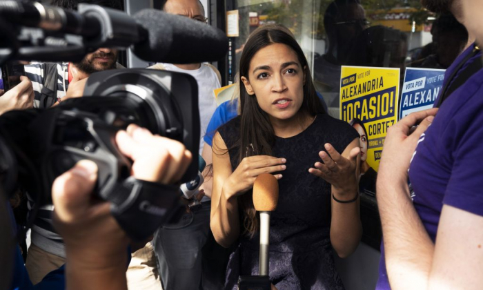 Democratic congressional candidate Alexandria Ocasio-Cortez speaks with  reporters after her general campaign kick-off rally on Sept. 22, 2018 in the Bronx borough of New York. (Don EMMERT/AFP/Getty Images)