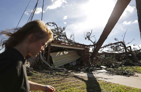 Kelsey Gronbeck walks damaged homes