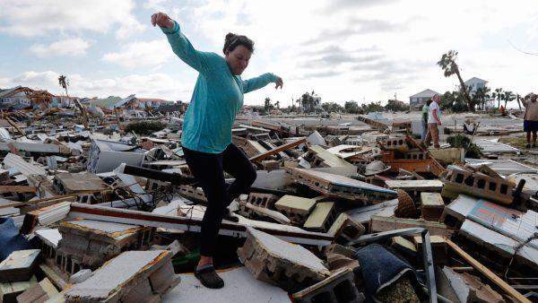 Mishelle climbs rubble home friend