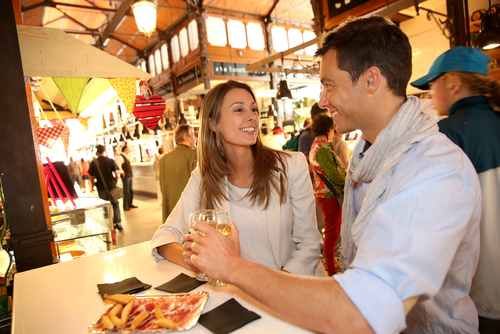 In tapas bars you can mingle with the locals, engage in good conversation, and sample a glass of Spanish wine or beer for just a few euros. (Shutterstock)