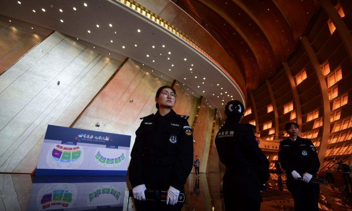 Security guards stand at the entrance of the Wanda Qingdao Movie Metropolis before its opening ceremony in Qingdao, China's Shandong province on April 28, 2018. (WANG ZHAO/AFP/Getty Images)