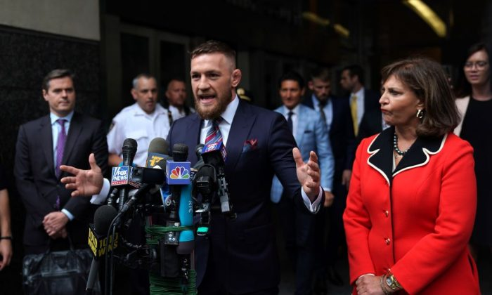 Conor McGregor talks to the press on July 26, 2018, in New York, after he pleaded guilty to a single violation of disorderly conduct after attacking a bus filled with UFC fighters. (Timothy A. Clary/AFP/Getty Images)