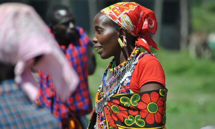 Nariku Kuyo converses with her friends at the Naikarra market in Narok County, Kenya, on May 4, 2018. (Dominic Kirui/Special to The Epoch Times)