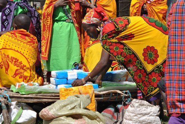 Nariku Kuyo arranges her items for sale at Naikarra market.