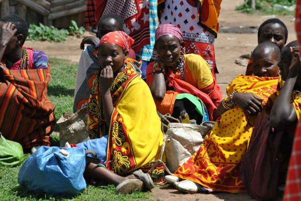 Women sit while waiting for their husbands to sell cattle or goats.
