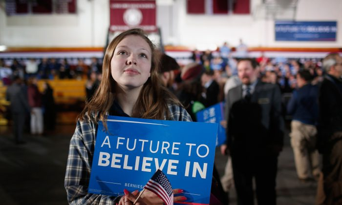 A Bernie Sanders supporter at the candidate's New Hampshire Primary Night watch party on Feb 9, 2016.  Millennials loved his brand of utopian socialism. They forgot the reality of the 20th century was different. (Win McNamee/Getty Images)