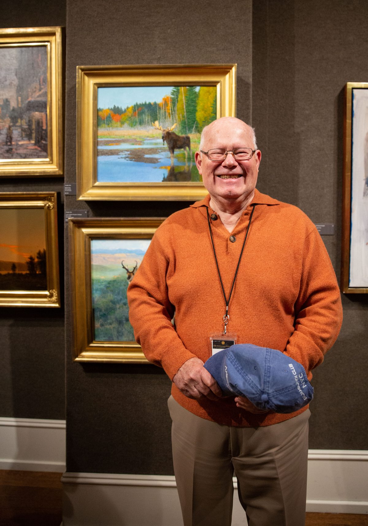 Living Legend artist, Douglas Allen poses for a photo by his paintings during the 10th American Masters at the Salmagundi Club on October 13, 2018. (Milene Fernandez/The Epoch Times)