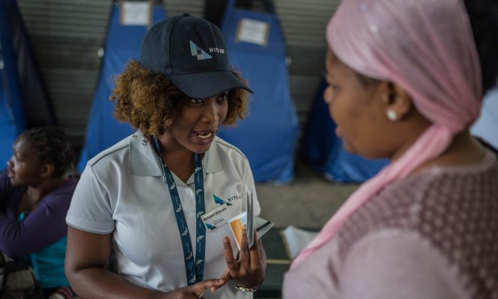 A university student explains how to use a HIV self-test kit, in Hillbrow, Johannesburg, South Africa, on March 19, 2018. (Mujahid Safodien  /AFP/Getty Images)