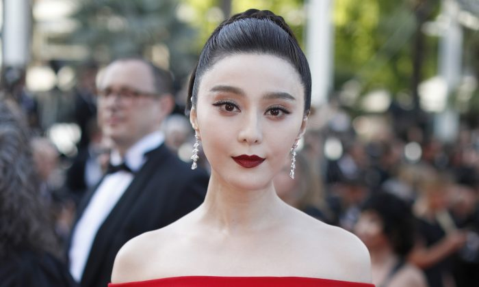 Fan Bingbing poses for photographers upon arrival at the screening of the film The Beguiled at the 70th international film festival, Cannes, southern France on May 24, 2017. (Thibault Camus/AP)