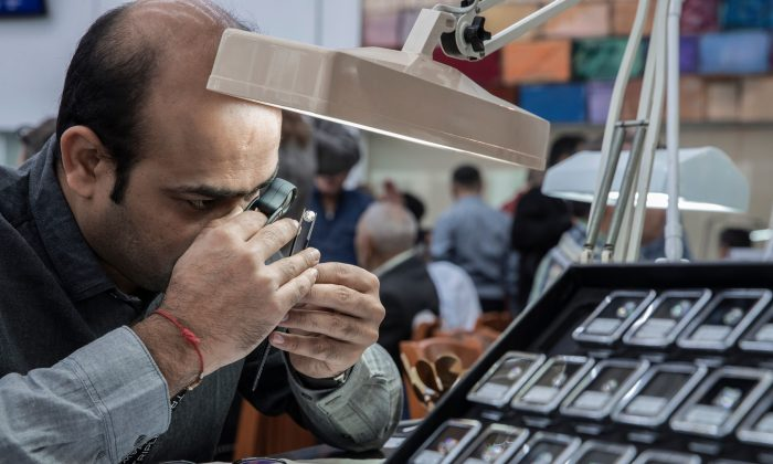 A foreign buyer checks the quality of a diamond in the Israeli town of Ramat Gan, east of Tel Aviv, on Feb. 5, 2018. (Jack Guez/AFP/Getty Images)