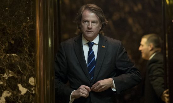 Don McGahn, then-general counsel for the Trump transition team, gets into an elevator in the lobby at Trump Tower in New York City on Nov. 15, 2016. (Drew Angerer/Getty Images)