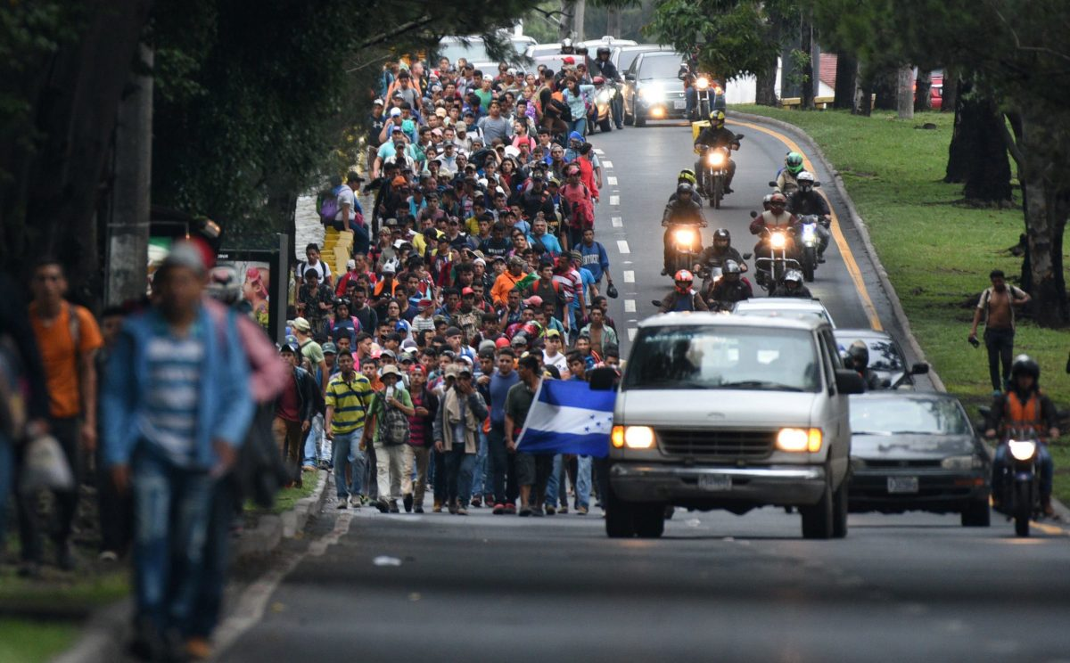 Honduran migrants heading in a caravan to the United States, walk in direction to the border with Mexico as they leave Guatemala City