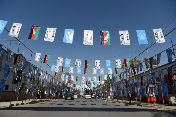 Afghan commuters posters parliamentary election