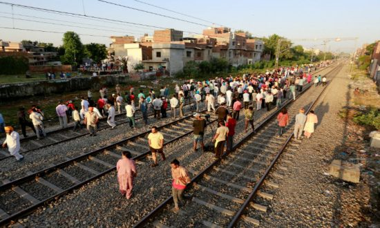 Indian Officials Exchange Blame for Train Plowing Into Festival Crowd