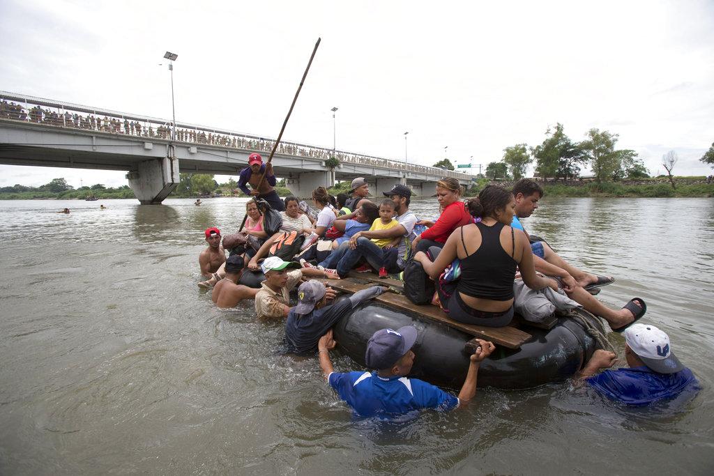 Migrants illegally enter Mexico
