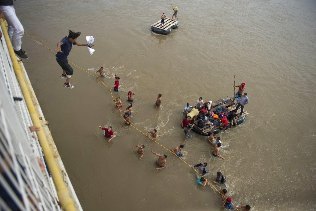 migrants jump off bridge