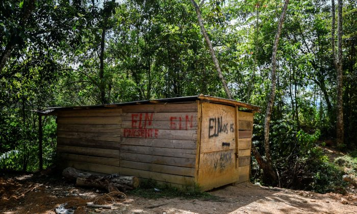 A house painted with the initials of the leftist Colombian guerrilla National Liberation Army (ELN) is seen in the Catatumbo jungle in Colombia on Sept. 20. (Luis Robayo/AFP/Getty Images)