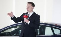 Musk Duels Panasonic in Rare Public Battle With Key Supplier