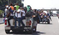 Migrant Caravan Adds Thousands as Hondurans Burn American Flags and Trump Cuts Aid
