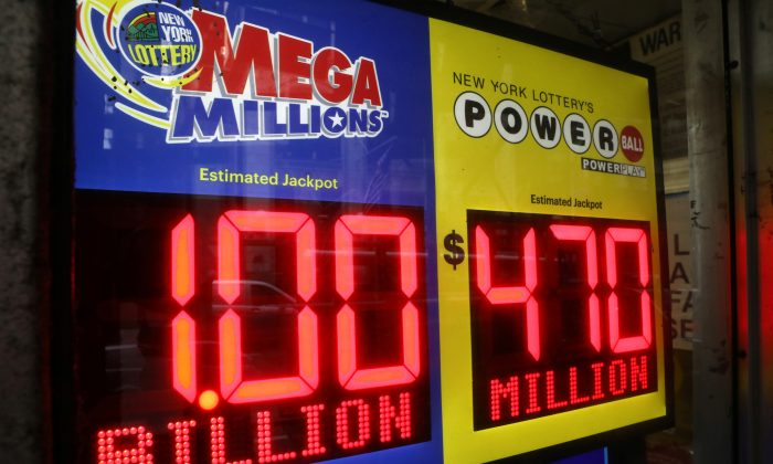 File photo of signs displaying the jackpots for Mega Millions and Powerball lottery drawings at a newsstands in midtown Manhattan in New York, on Oct. 19, 2018. (Mike Sugar/Reuters)