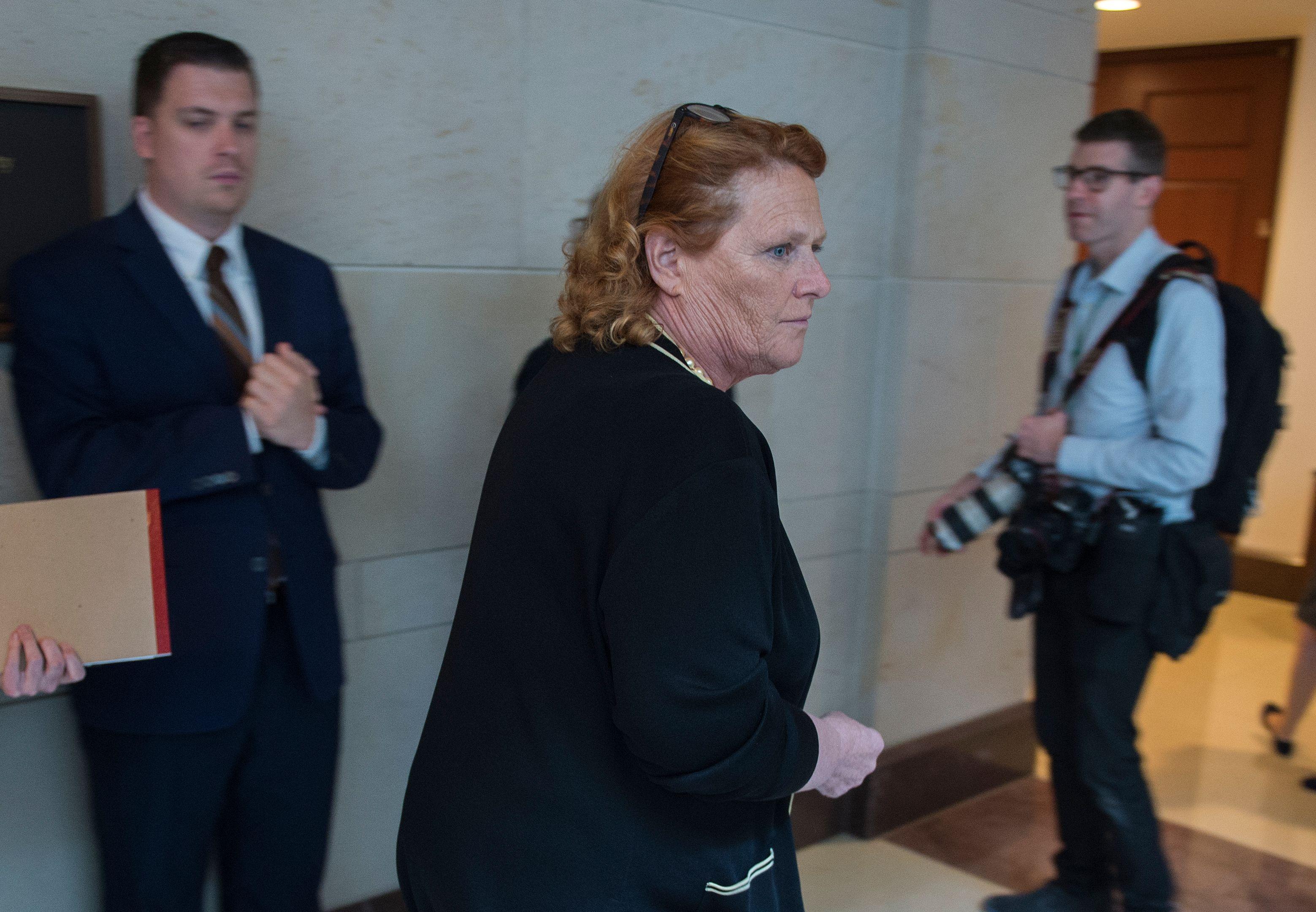 Senator Heidi Heitkamp (2nd R) on Capitol Hill