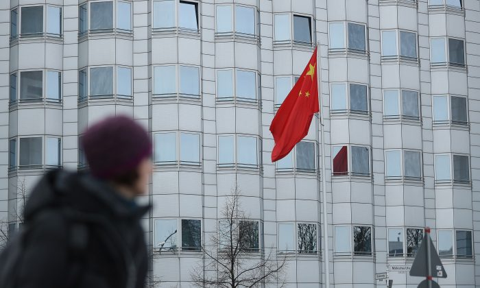 A woman walks past the Chinese Embassy on December 11, 2017 in Berlin, Germany. (Sean Gallup/Getty Images)