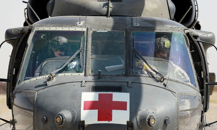 A MEDEVAC helicopter drops of a patient at a hospital in Kandahar, Afghanistan, in 2010. In business, no matter how good your team is, you will always need support from specialists. (Justin Sullivan/Getty Images)