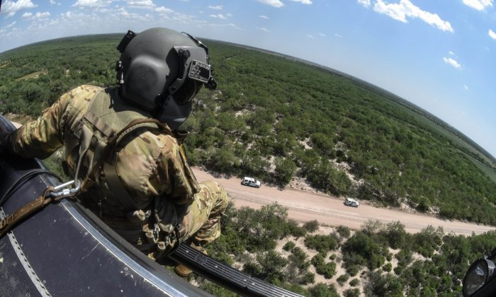 Army National Guard soldiers provide airborne support to the U.S. Department of Homeland Security (DHS) during Operation Guardian Support in proximity of the southwest border in McAllen, Rio Grande valley, Tex., in July 2018. (U.S. Army National Guard/Staff Sgt. Roberto Di Giovine)