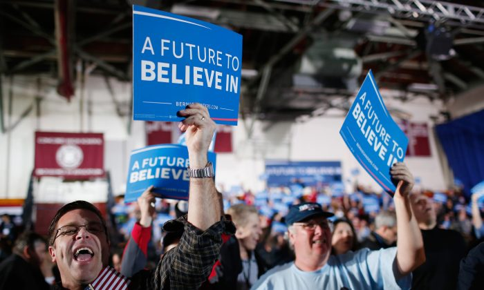 Bernie Sanders supporters at the candidate's New Hampshire Primary Night watch party on Feb 9, 2016 in Concord, New Hampshire. Many Sanders supporters believe socialism can deliver the goods, when the opposite it true. (Win McNamee/Getty Images)