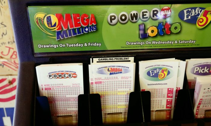 Lottery forms for Louisiana Mega Millions, Powerball and other lottery games fill the drawer at The World Bar and Grill, in Delta, La., on Oct. 23, 2018. (Rogelio V. Solis/AP)