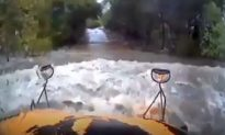 Dashcam Video: School Bus Driver Tries to Enter Flooded Road, Gets Swept