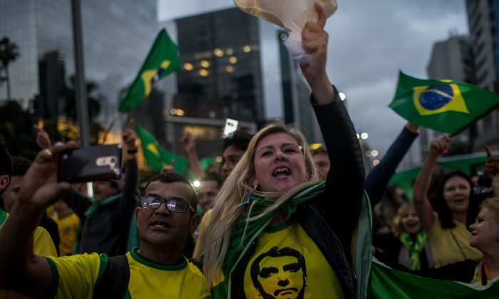 Supporters of Jair Bolsonaro celebrate victory in the presidential elections on Oct. 28, 2018, in Sao Paulo, Brazil. (Victor Moriyama/Getty Images)