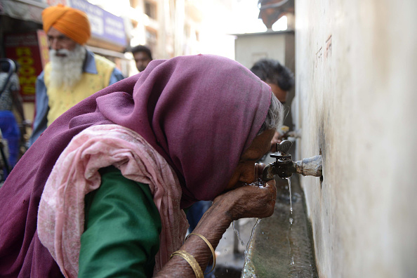 An Indian woman drinks water from a tap on March 22, 2018. World Water Day focuses on the importance of universal access to clean water, sanitation and hygiene facilities. (Narinder Nanu/AFP/Getty Images)
