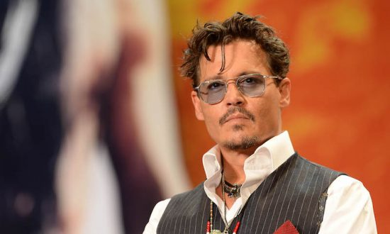 """Johnny Depp on July 17, 2013, in Tokyo, Japan. Johnny Depp has been dropped from the """"Pirates Of the Caribbean"""" film franchise. (Atsushi Tomura/Getty Images)"""