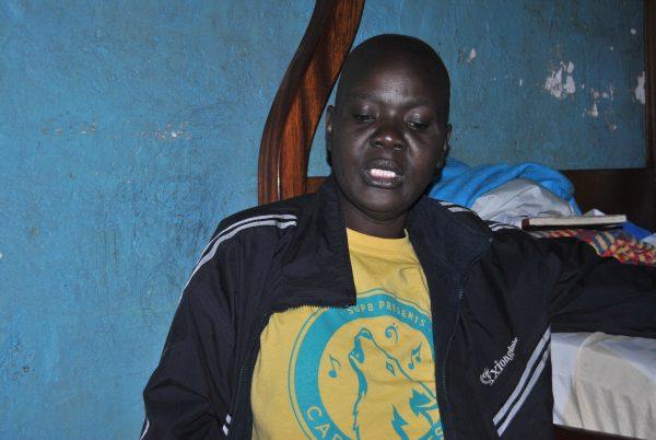 Caroline Achieng', a breast cancer patient living in Kariobangi slums in Nairobi.