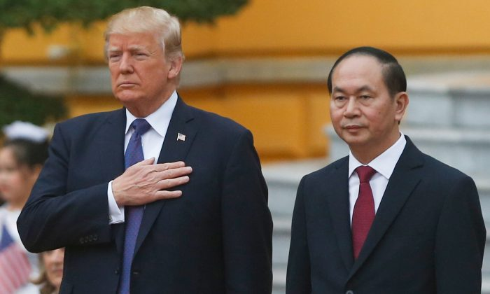 U.S. President Donald Trump (L) and Vietnam's President Tran Dai Quang attend a welcoming ceremony at the Presidential Palace in Hanoi on November 12, 2017. (KHAM/AFP/Getty Images)