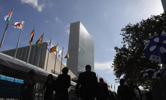 People walk past the United Nations headquarters in New York City on Sept. 26, 2018. (John Moore/Getty Images)