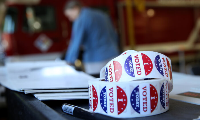 """A roll of """"I Voted"""" stickers sit on a table inside a polling station at a Ross Valley fire station in San Anselmo, Calif. on June 5, 2018. (Photo by Justin Sullivan/Getty Images)"""
