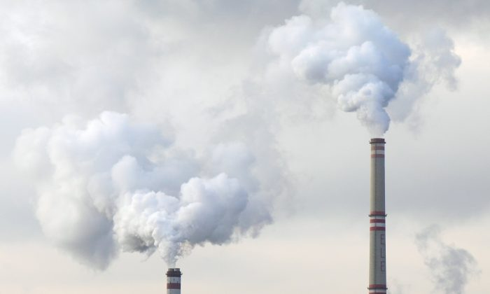 Power plant chimney spew clouds of gas and particles into the air. Air pollution standards set by the EPA have become stricter over the years, and now may be impossible to achieve. (PublicDomainPictures/pixabay.com)